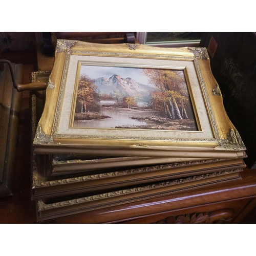 35 - An assortment of framed paintings & prints in decorative gilt frames....
