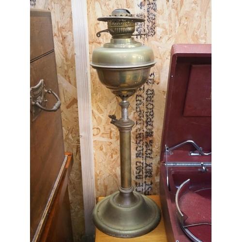 42 - An antique brass oil lamp....