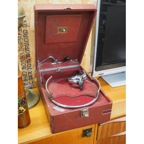 44 - An antique portable gramophone with red case....