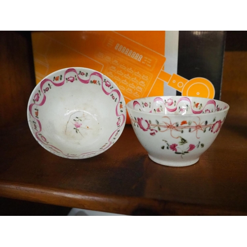 59 - A stunning pair of antique hand painted tea bowls....