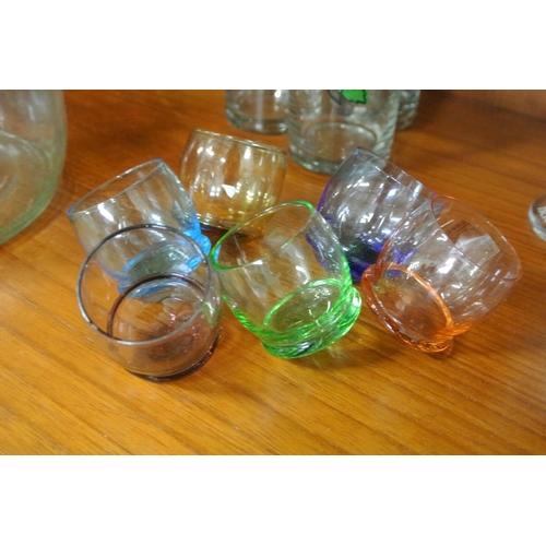 11 - A set of 6 vintage coloured shot glasses....