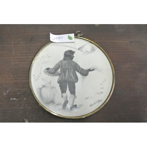 23 - A framed print of a boy in snow....