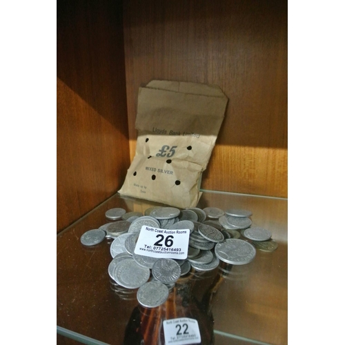 26 - An assortment of vintage alloy coinage....