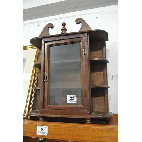 32 - A small wall mounted display cabinet....