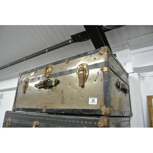 34 - A vintage metal bound steamer chest/ trunk....