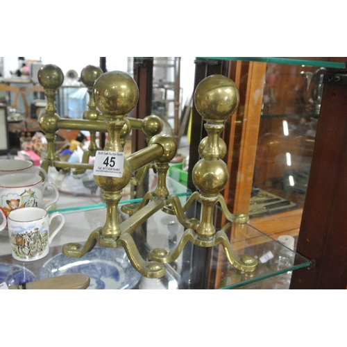 45 - A pair of antique brass fire dogs....