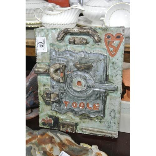 60 - A decorative studio pottery plaque....