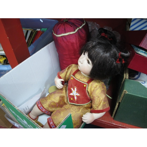 1022 - A Modern Alberon Ceramic Doll, with cushion, 44cm high.