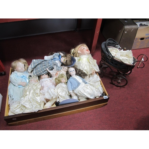 1045 - Eight Modern Porcelain Collectors Dolls; plus a small porcelain doll in antique style pushchair. (2)...