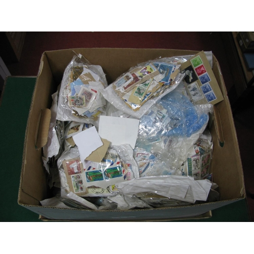 130 - A Large Carton of GB and World Used Stamps, in packets and on album leaves, many thousands....
