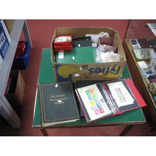 143 - A Large Box of Stamps, club books, on leaves and loose, includes an empire album (empty)many thousan...