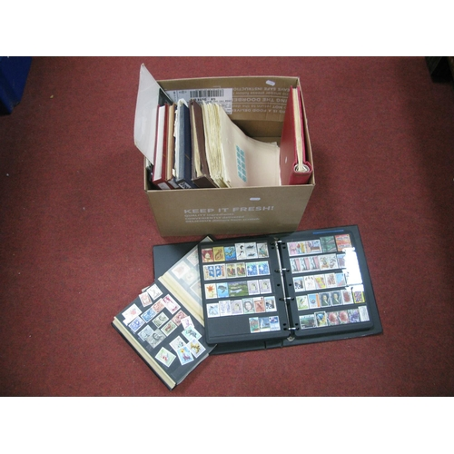 165 - A Collection of World Stamps, in eleven binders/stockbooks and a decent collection of Germany mainly...