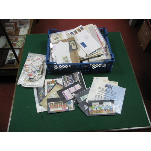 169 - A Collection of Australian Stamps and Postal History, in a stockbook, packets and on album leaves, f...