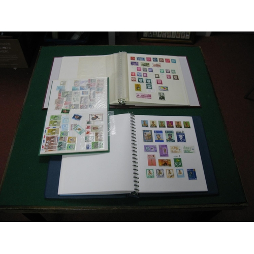 187 - Two Albums and a Stockbook of World Stamps, from Argentina, Belgium,, Eire, Italy, Egypt, Israel, Ja...