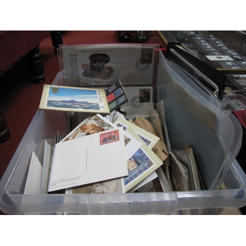 216 - A Carton Containing a Collection of G.B and World First Day Covers, postcards, G.B presentation pack...
