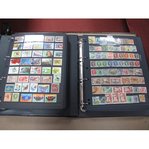 273 - Two Four Ring Binders, housing a collection of stamps, mixed mint and used including Japan, Iran, Ni...