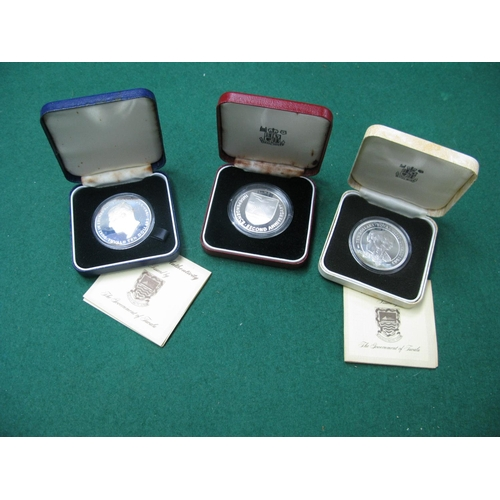 493 - Three Crown Sized Coins, including silver proof Tuvalu ten dollars 1982, 1981, mostly accompanied by...