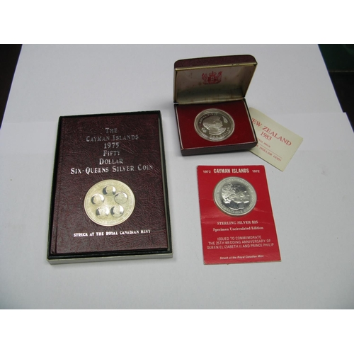 559 - Three Modern Silver Commemorative Coins, including The Cayman Islands 1975 fifty dollar six queens s...