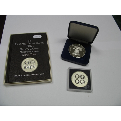 560 - Three Silver Proof Commemorative Coins, to include The Turks and Caicos Islands 20 crowns coins 1976...