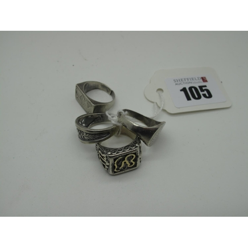 105 - A Middle Eastern Style Gent's Ring, the rectangular panel between tapered shoulders, of abstract des...