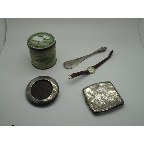 33 - A Hallmarked Silver Cigarette Case, Birmingham 1905, (squashed/damaged) (84grams); a hallmarked silv...