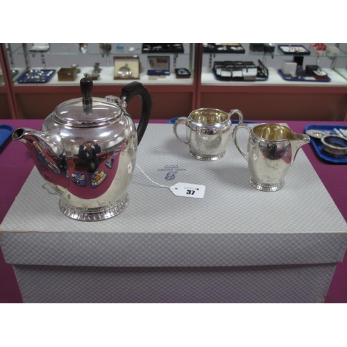 37 - A Hallmarked Silver Three Piece Tea Set, JD&S, Sheffield 1945, each of plain circular form with text...