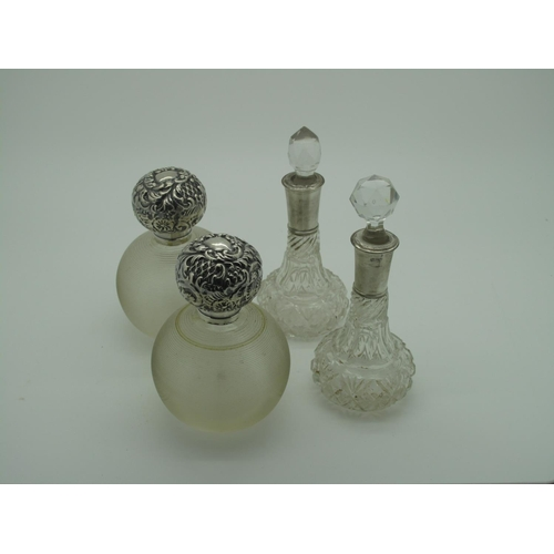 42 - A Pair of Hallmarked Silver Topped Globular Glass Scent Bottles, London 1904; together with a pair o...
