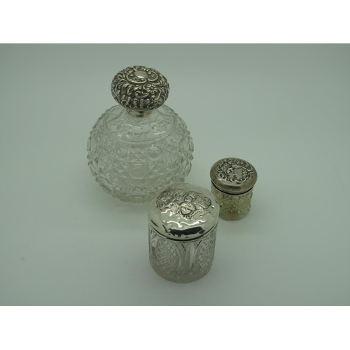 44 - A Large Hallmarked Silver Topped Globular Glass Scent Bottle, London 1901; together with two hallmar...