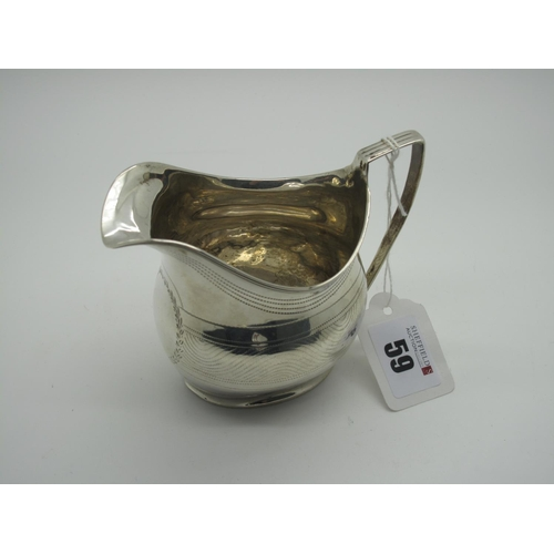 59 - A Hallmarked Silver Cream Jug, (marks rubbed) with prick dot details and reeded edge and angular loo...