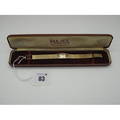 83 - Majex; A Vintage 9ct Gold Cased Ladies Wristwatch, the signed rectangular dial with line markers, wi...