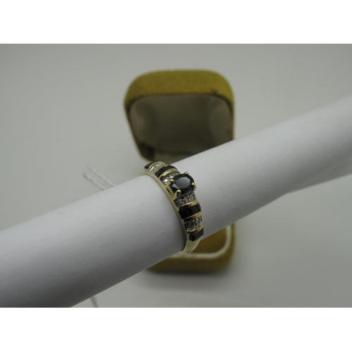 98 - A 14ct Gold Sapphire and Diamond Set Ring, oval four claw set to the centre, between alternate shoul...