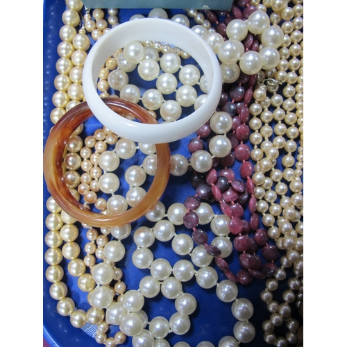27 - A Mixed Lot of Assorted Costume Jewellery, bead necklaces, imitation pearl beads, a gilt coloured Je...