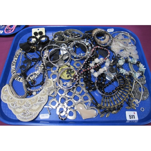 511 - A Variety of Modern Costume Jewellery, including ornate necklaces, fancy drop earrings, bead necklac...