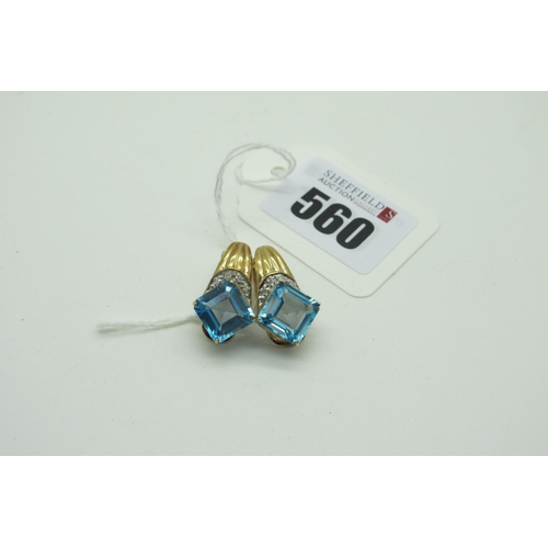 560 - A Pair of Modern 9ct Gold Single Stone Clip Earrings, (unpierced), square four claw offset (total we...