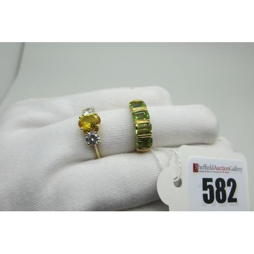 582 - A Modern DQCZ Three Stone Dress Ring, graduated claw set, stamped