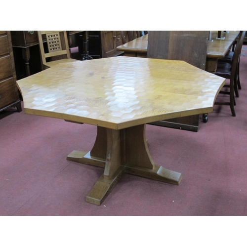 809 - A Robert Thompson (Mouseman) Oak Octagonal Dining Table, raised on a cross base, carved mouse signat...