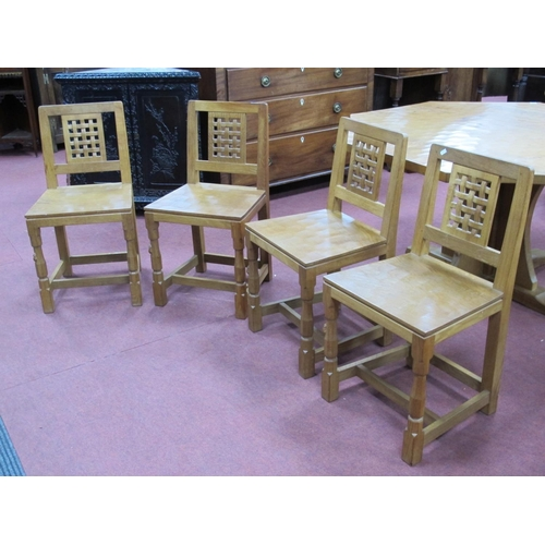 808 - A Robert Thompson (Mouseman) Set of Four Oak Lattice Back Dining Chairs, on octagonal front legs, ca...