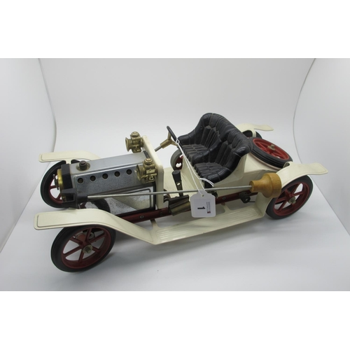 1 - A Mamod Steam Car, appears complete including burnel and steering rod, appears unsteamed, unboxed.