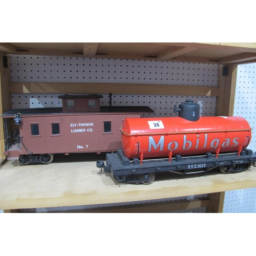24 - Two G Scale Eight Wheel Railway Wagons, an LGB 'Mobilgas' Tanker and a caboose, playworn.