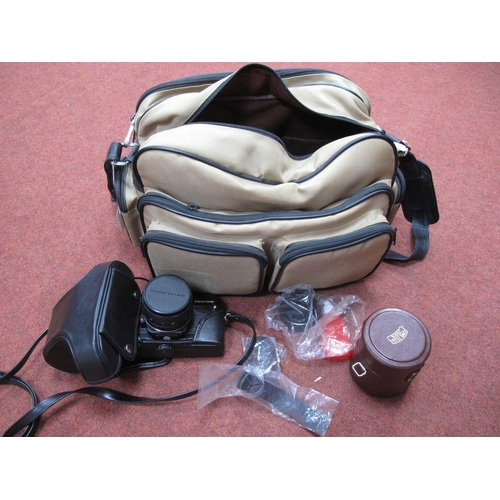738 - Praktica BCI Electronic, with Pentacon f=50mm lens, in leather case, Carl Zeiss Jena II 28mm lens in...