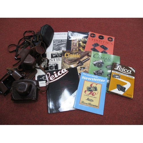 760 - Camera Cases, all in various stages of wear:- Leica, Zenit etc, also Leica book and catalogues.