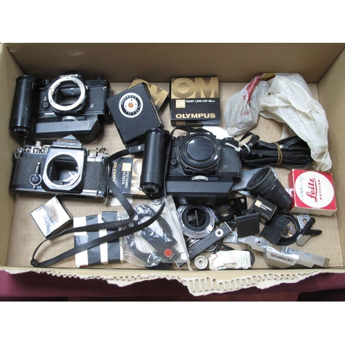772 - Olympus OM-1 Camera Body, plus two other Olympus bodies with lots of parts and Photax 131 flash and ...