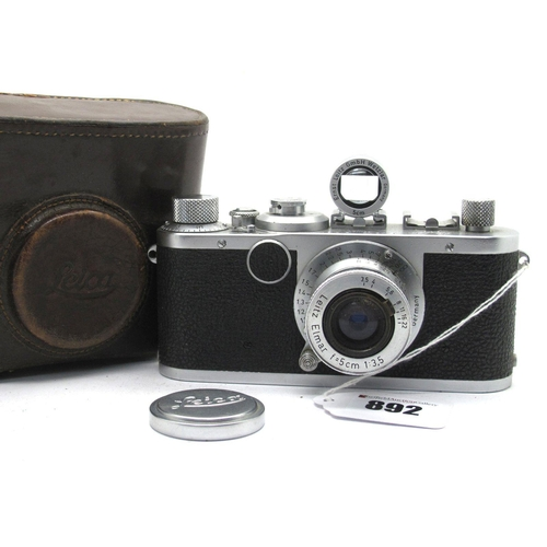 892 - Leica Camera No 520497 1950/1 Range Finder, with Elmar f=5cm 1:3.5 lens, in brown leather case,