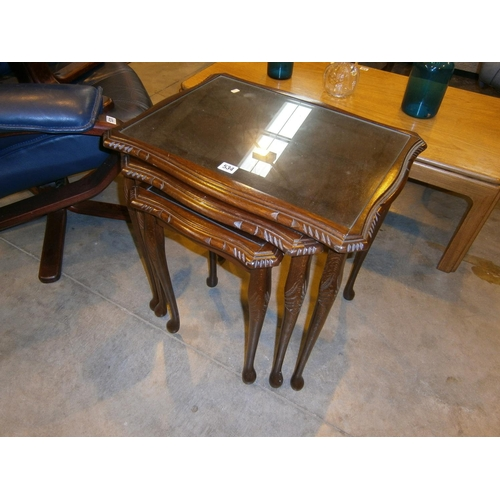 Mahogany and Glass Top nest of 3 Tables