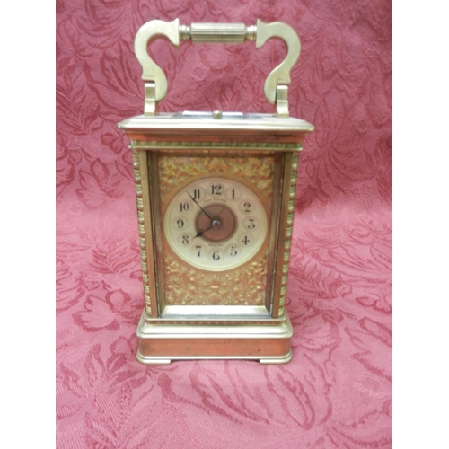 41 - A Victorian carriage clock retailed by Chas Deprez of Bristol, cream enamel dial, repeating striking...