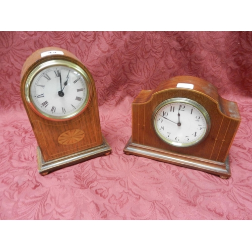 44 - An Edwardian mantel clock, white enamel dial, in a mahogany case with dome shaped top, inlaid oval p...