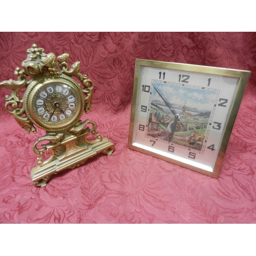 51 - A strut clock with square silvered chapter ring, the centre with Swiss landscape, in a brass case - ...