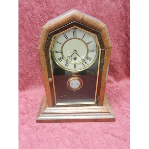 60 - A Victorian mantel clock with cream enamel dial, in a walnut and crossbanded case - 17 1/2in. high...