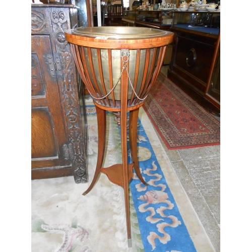 39 - An Edwardian mahogany and inlaid jardiniere stand with slatted sides, brass liner, on three splayed ...