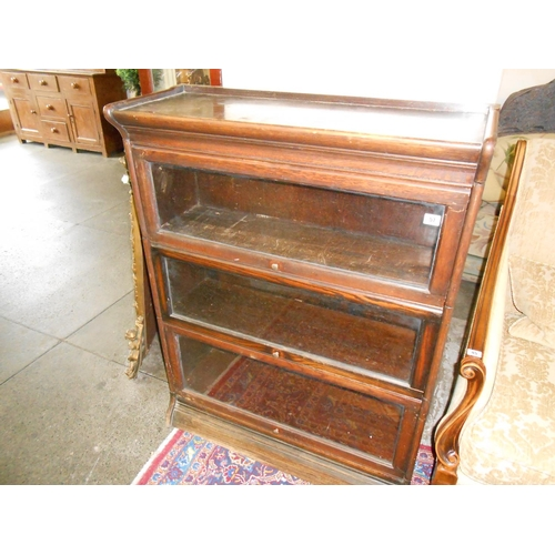 56 - An oak three section Globe Wernicke style bookcase...